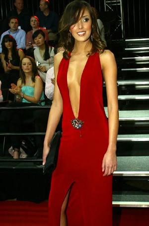 Rebecca Twigley's Plunging red dress at the Brownlow